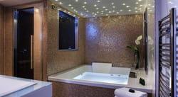 outre les salles de bains aussi design que spacieuses il propose un espace dtente avec sauna et salle de massage - Salle De Bain Avec Sauna